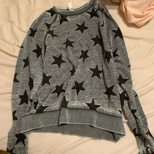 grey pullover with black stars